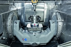 <p>Figure 1 shows the working area of a C 22 U high-performance five-axis machining centre featuring the 320 mm diameter NC swivelling rotary table with a multi-clamp system installed on it (0877)  </p>