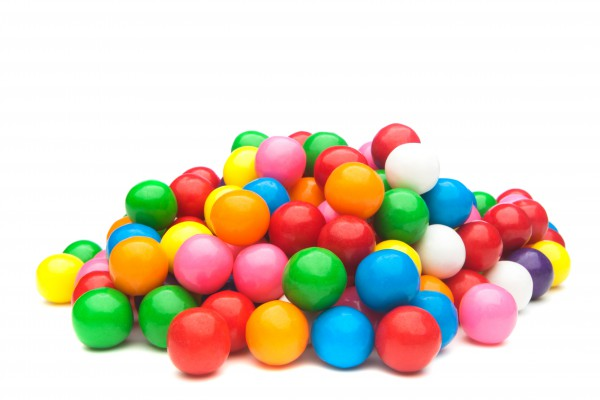 <p>A pile of colorful gumballs on a white background.</p>